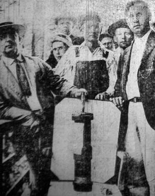 UMW officials and members of the miners army display a bomb dropped on them during the Battle of Blair Mountain, December, 1921.
