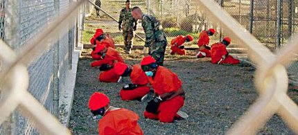 Detainees at Guantanamo Bay are watched by military police. (photo: Reuters)