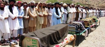 Pakistani villagers offer funeral prayers for people who were reportedly killed by a U.S. drone attack, 06/16/11. (photo: AP)