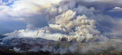 Smoke rises from the Waldo Canyon wildfire in Colorado Springs, Colorado, 06/27/12. (photo: Reuters)