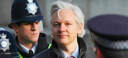 WikiLeaks founder Julian Assange awaits decision on his application for asylum as diplomatic row brews between UK and Ecuador. (photo: Kirsty Wigglesworth/AP)