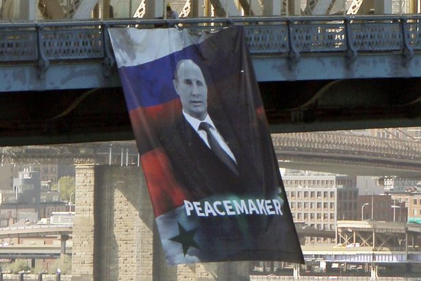 Dictator or Peacemaker? A Vladimir Putin banner hanging off the Manhattan Bridge in early October.