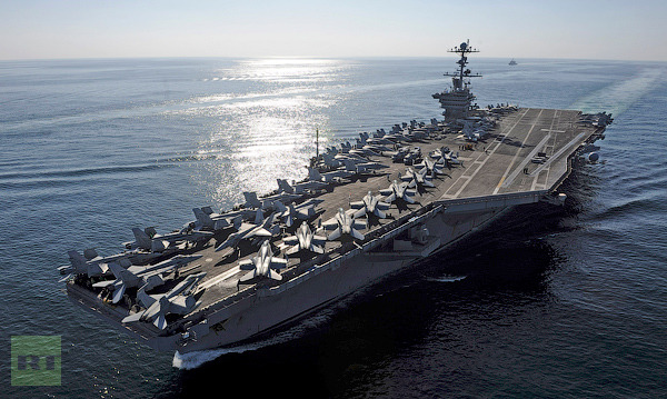 The aircraft carrier USS John C. Stennis transits the Straits of Hormuz in this U.S. Navy handout photo dated November 12, 2011 (Reuters/U.S. Navy/Mass Communication Specialist 3rd Class Kenneth Abbate/Handout)