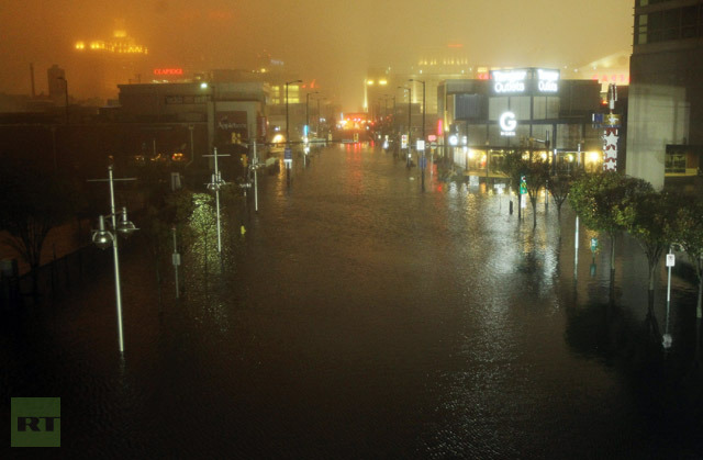 A flooded street is seen at nightfall during rains from Hurricane Sandy on October 29, 2012 in Atlantic City, New Jersey. (Mario Tama/Getty Images/AFP)