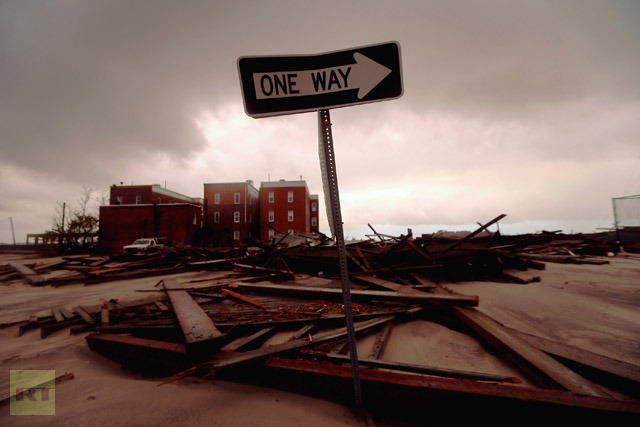 A street sign stands near apartment buildings which flooded and destroyed large sections of an old boardwalk, on October 30, 2012 in Atlantic City, New Jersey. (Mario Tama/Getty Images/AFP)