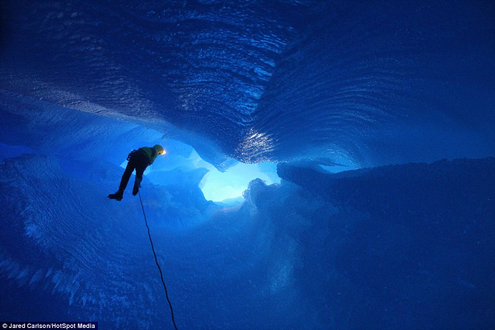 Climber Jason Nelson manoeuvres through Mendenhall Glacier in Juneau, Alaska as the pair tackle a moulin shaft