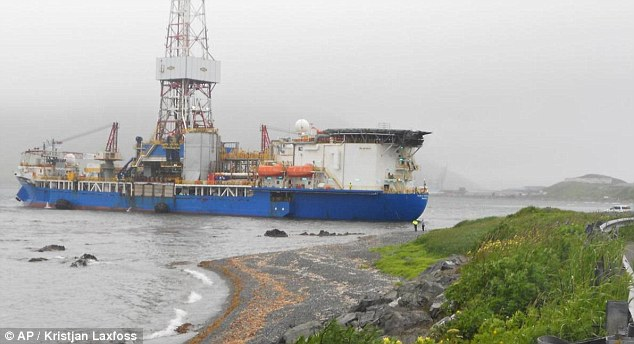 Shell oil drilling rig the Noble Discoverer lies in Alaska's Dutch Harbor after losing its mooring on Saturday