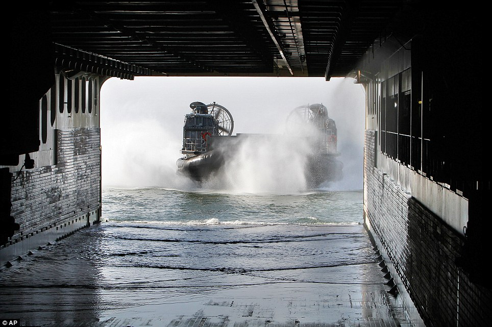 Exercise: A U.S. Navy landing craft lands in the dock of French ship Mistral to load equipment