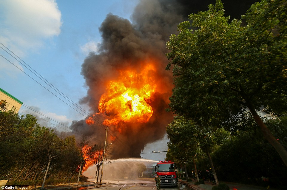 Firefighters battle a fire at a chemical plant after explosion on September 7 in Lishui, China. No injuries were reported as a result of the fire
