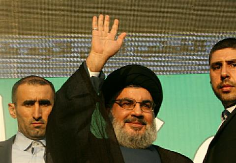 File - Hezbollah leader Sayyed Hasan Nasrallah waves to the crowd in Beirut, on Monday, Sept. 17, 2012. (The Daily Star/Hasan Shaaban)