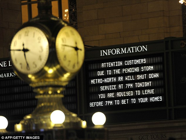 Head for the hills: A sign in Grand Central on Sunday evening as New York braced for Hurricane Sandy