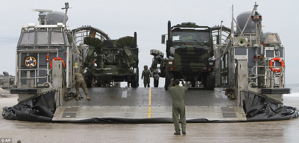 Intelligence: Trucks prepare to drive off the Navy LCAC after it made landfall. The week of exercises will also see Marines storm a fort from the air
