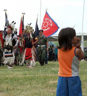 A child watches a Color Guard Veteran's Pow Wow at the Pine Ridge Indian Reservation
