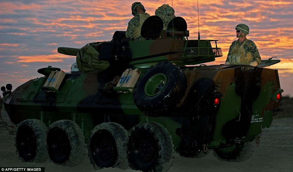 Night fighting: An amphibious assault vehicle drives ashore as the sun sets in North Carolina