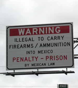 Sign by Mexican Border