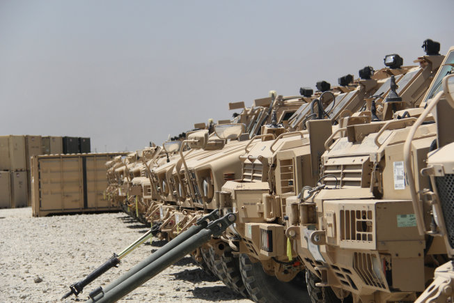 U.S. military vehicles seen in a row.